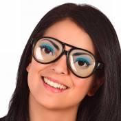 Lunettes à monture noire avec des yeux dessinés sur les verres