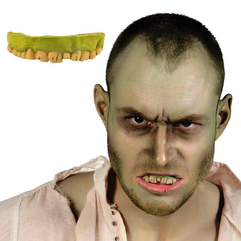 Dentier de zombie avec des dents jaunes et la gencive verte