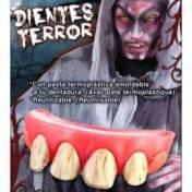 Dentier avec quatre dents jaunes